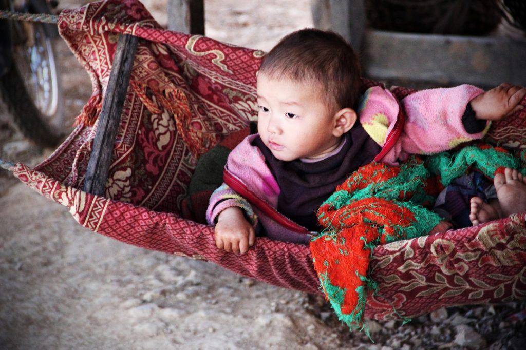 chinese baby in a swing